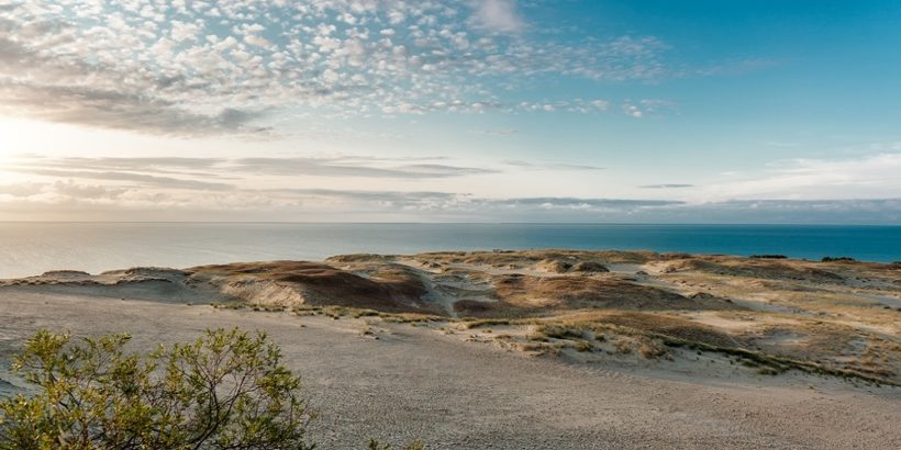 Sunrise over dunes and Baltic Sea. Curonian Spit, Nida, Lithuani